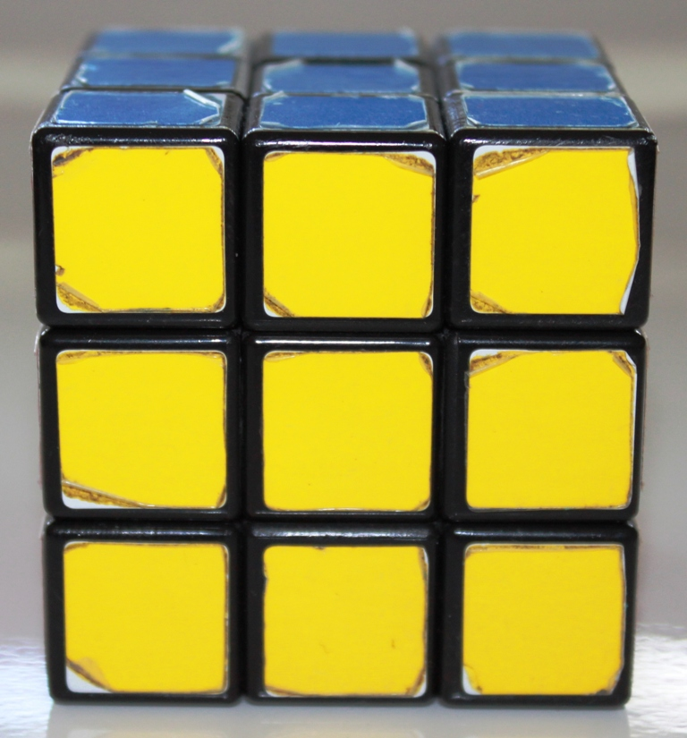 Rubik's Cube, blue face on top, yellow at front
